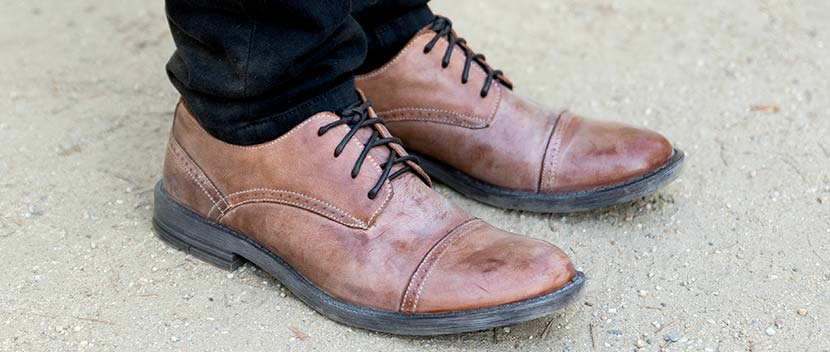 Pair of tan leather cap toe oxford Alonzo shoes worn with Black denim